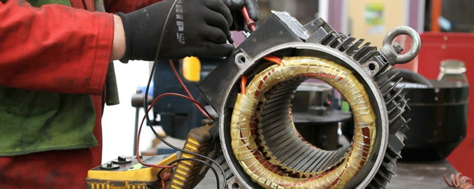 Engineer electrically testing an AC Motor